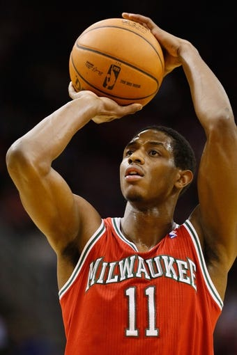 Jan 18, 2014; Houston, TX, USA; Milwaukee Bucks guard Brandon Knight (11) shoots a free throw during the second half against the Houston Rockets at Toyota Center. The Rockets won 114-104. Mandatory Credit: Soobum Im-USA TODAY Sports