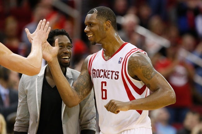Jan 18, 2014; Houston, TX, USA; Houston Rockets forward Terrence Jones (6) celebrates a score with teammate Patrick Beverley (suit) during the second half against the Milwaukee Bucks at Toyota Center. The Rockets won 114-104. Mandatory Credit: Soobum Im-USA TODAY Sports