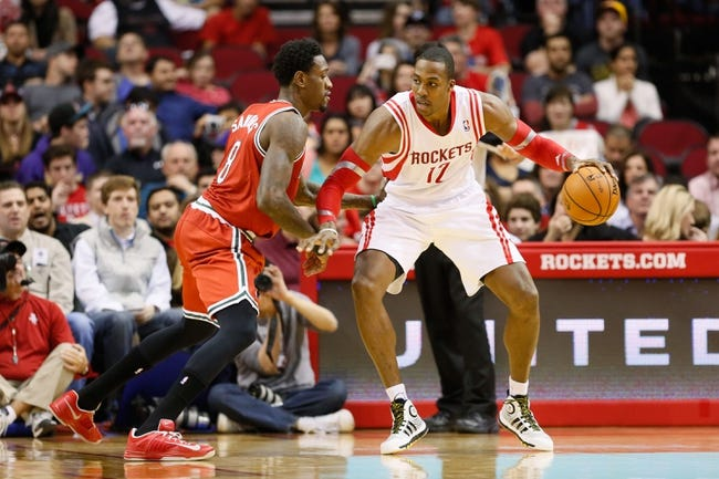Jan 18, 2014; Houston, TX, USA; Houston Rockets center Dwight Howard (12) is defended by Milwaukee Bucks center Larry Sanders (8) during the first half at Toyota Center. Mandatory Credit: Soobum Im-USA TODAY Sports