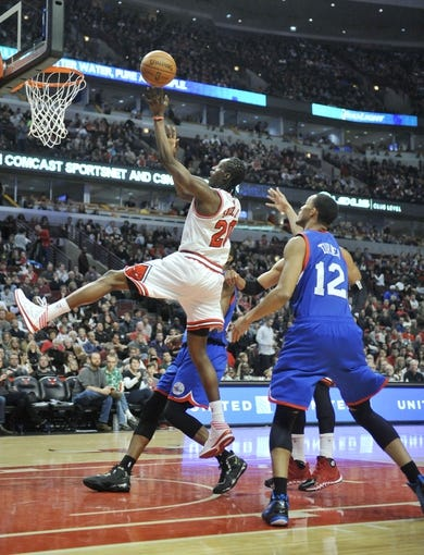 Jan 18, 2014; Chicago, IL, USA;  Chicago Bulls shooting guard Tony Snell (20) is defended by Philadelphia 76ers small forward Evan Turner (12) during the second half at the United Center. The Chicago Bulls defeated the Philadelphia 76ers 103-78. Mandatory Credit: David Banks-USA TODAY Sports