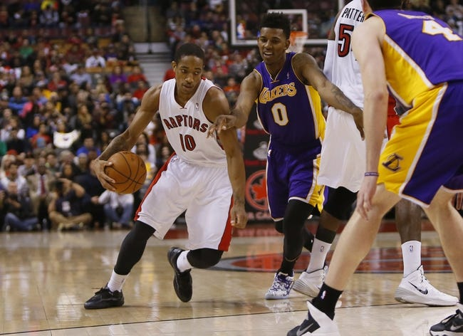 Jan 19, 2014; Toronto, Ontario, CAN; Toronto Raptors guard DeMar DeRozan (10) drives to the net against Los Angeles Lakers forward-guard Nick Young (0) and forward Ryan Kelly (4) during the first half at the Air Canada Centre. Mandatory Credit: John E. Sokolowski-USA TODAY Sports