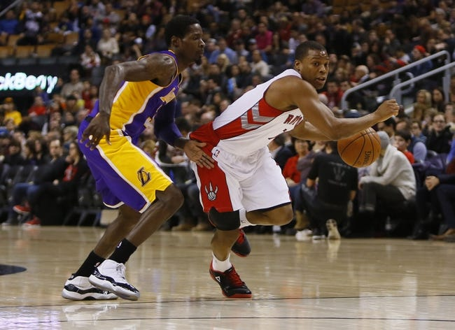 Jan 19, 2014; Toronto, Ontario, CAN; Toronto Raptors guard Kyle Lowry (7) carries the ball as Los Angeles Lakers guard Manny Harris (3) defends during the first half at the Air Canada Centre. Mandatory Credit: John E. Sokolowski-USA TODAY Sports