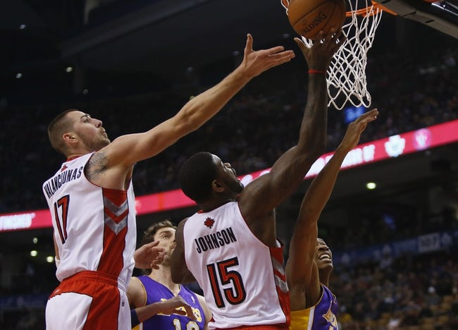 Jan 19, 2014; Toronto, Ontario, CAN; Toronto Raptors center Jonas Valanciunas (17) and forward-center Amir Johnson (15) and Los Angeles Lakers forward Wesley Johnson (11) and center-forward Pau Gasol (16) battle for a rebound during the first half at the Air Canada Centre. Mandatory Credit: John E. Sokolowski-USA TODAY Sports