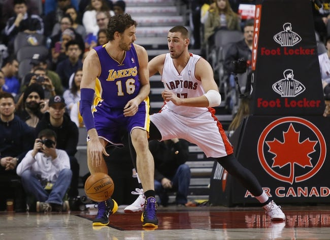 Jan 19, 2014; Toronto, Ontario, CAN; Toronto Raptors center Jonas Valanciunas (17) defends against Los Angeles Lakers center-forward Pau Gasol (16) during the first half at the Air Canada Centre. Mandatory Credit: John E. Sokolowski-USA TODAY Sports