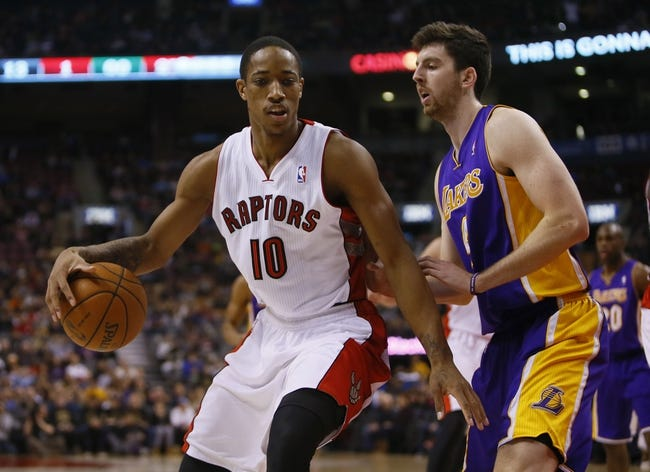 Jan 19, 2014; Toronto, Ontario, CAN; Toronto Raptors guard DeMar DeRozan (10) controls the ball against Los Angeles Lakers forward Ryan Kelly (4) during the first half at the Air Canada Centre. Mandatory Credit: John E. Sokolowski-USA TODAY Sports