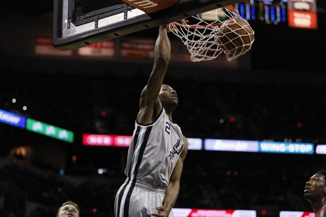 Jan 19, 2014; San Antonio, TX, USA; San Antonio Spurs forward Kawhi Leonard (2) dunks during the first half against the Milwaukee Bucks at AT&T Center. Mandatory Credit: Soobum Im-USA TODAY Sports