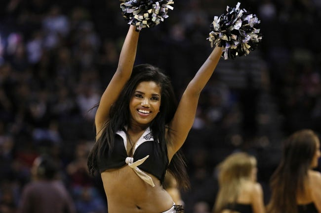 Jan 19, 2014; San Antonio, TX, USA; San Antonio Spurs cheerleader performs during the first half against the Milwaukee Bucks at AT&T Center. Mandatory Credit: Soobum Im-USA TODAY Sports