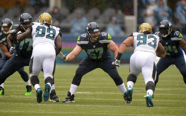 Sep 22, 2013; Seattle, WA, USA; Seattle Seahawks guard Paul McQuistian (67) defends against Jacksonville Jaguars defensive tackle Sen'Derrick Marks (99) and defensive end Tyler Alualu (93) at CenturyLink Field. The Seahawks defeated the Jaguars 45-17. Mandatory Credit: Kirby Lee-USA TODAY Sports