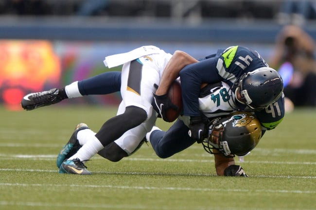 Sep 22, 2013; Seattle, WA, USA; Seattle Seahawks cornerback Byron Maxwell (41) tackles Jacksonville Jaguars receiver Cecil Shorts III (84) at CenturyLink Field. The Seahawks defeated the Jaguars 45-17. Mandatory Credit: Kirby Lee-USA TODAY Sports