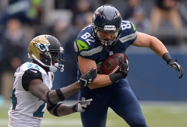 Sep 22, 2013; Seattle, WA, USA; Seattle Seahawks tight end Luke Wilson (82) is defended by Jacksonville Jaguars cornerback Will Blackmon (24) at CenturyLink Field. The Seahawks defeated the Jaguars 45-17. Mandatory Credit: Kirby Lee-USA TODAY Sports