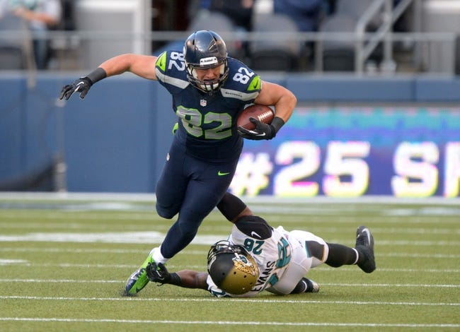 Sep 22, 2013; Seattle, WA, USA; Seattle Seahawks tight end Luke Wilson (82) attempts to elude Jacksonville Jaguars safety Josh Evans (26) at CenturyLink Field. The Seahawks defeated the Jaguars 45-17. Mandatory Credit: Kirby Lee-USA TODAY Sports