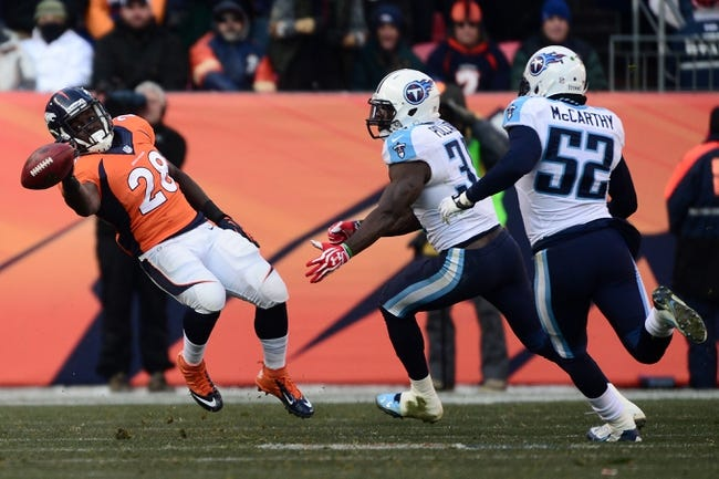 Dec 8, 2013; Denver, CO, USA;Denver Broncos running back Montee Ball (28) is defended by Tennessee Titans strong safety Bernard Pollard (31) and middle linebacker Colin McCarthy (52) in the second quarter against the Tennessee Titans at Sports Authority Field at Mile High. Mandatory Credit: Ron Chenoy-USA TODAY Sports