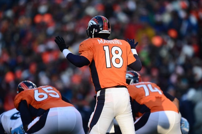 Dec 8, 2013; Denver, CO, USA; Denver Broncos quarterback Peyton Manning (18) calls out in the second quarter against the Tennessee Titans at Sports Authority Field at Mile High. Mandatory Credit: Ron Chenoy-USA TODAY Sports
