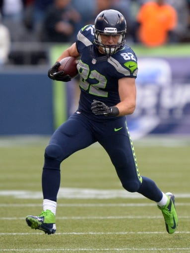 Sep 22, 2013; Seattle, WA, USA; Seattle Seahawks tight end Luke Wilson (82) carries the ball against the Jacksonville Jaguars at CenturyLink Field. The Seahawks defeated the Jaguars 45-17. Mandatory Credit: Kirby Lee-USA TODAY Sports