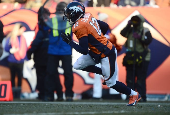 Dec 8, 2013; Denver, CO, USA; Denver Broncos wide receiver Andre Caldwell (12) returns in the second quarter against the Tennessee Titans at Sports Authority Field at Mile High. Mandatory Credit: Ron Chenoy-USA TODAY Sports