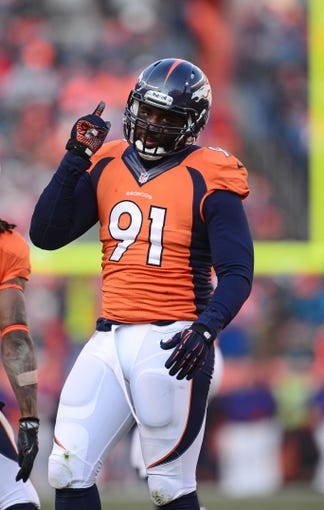 Dec 8, 2013; Denver, CO, USA; Denver Broncos defensive end Robert Ayers (91) reacts in the second quarter against the Tennessee Titans at Sports Authority Field at Mile High. Mandatory Credit: Ron Chenoy-USA TODAY Sports