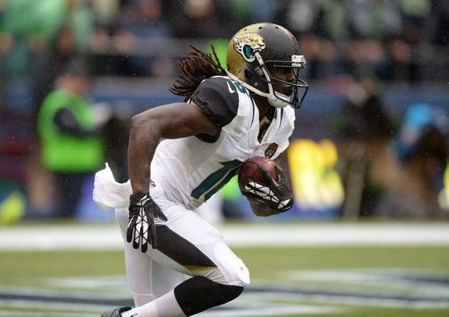 Sep 22, 2013; Seattle, WA, USA; Jacksonville Jaguars running back Denard Robinson (16) returns a kickoff against the Seattle Seahawks at CenturyLink Field. The Seahawks defeated the Jaguars 45-17. Mandatory Credit: Kirby Lee-USA TODAY Sports