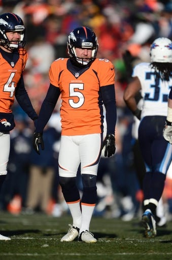 Dec 8, 2013; Denver, CO, USA; Denver Broncos kicker Matt Prater (5) and punter Britton Colquitt (4) in the second quarter against the Tennessee Titans at Sports Authority Field at Mile High. Mandatory Credit: Ron Chenoy-USA TODAY Sports