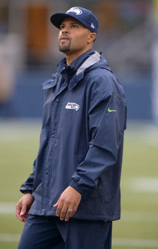 Sep 22, 2013; Seattle, WA, USA; Seattle Seahawks defensive backs coach Kris Richard before the game against the Jacksonville Jaguars at CenturyLink Field. Mandatory Credit: Kirby Lee-USA TODAY Sports