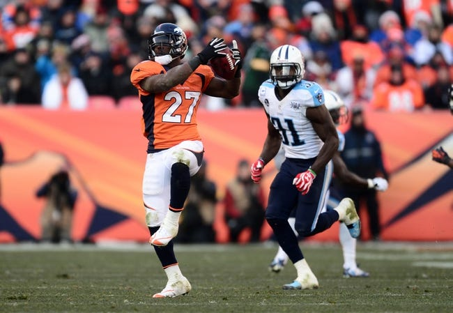 Dec 8, 2013; Denver, CO, USA; Denver Broncos running back Knowshon Moreno (27) against Tennessee Titans strong safety Bernard Pollard (31) in the second quarter at Sports Authority Field at Mile High. Mandatory Credit: Ron Chenoy-USA TODAY Sports