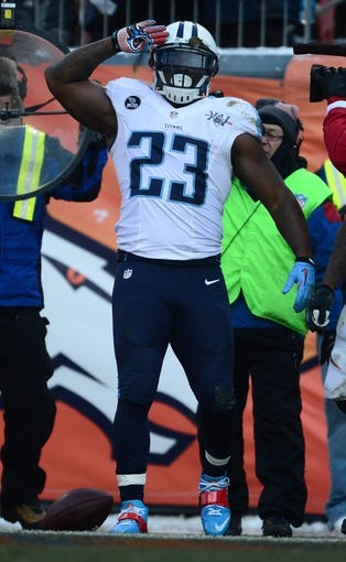 Dec 8, 2013; Denver, CO, USA; Tennessee Titans running back Shonn Greene (23) reacts to his touchdown in the second quarter against the Denver Broncos at Sports Authority Field at Mile High. Mandatory Credit: Ron Chenoy-USA TODAY Sports