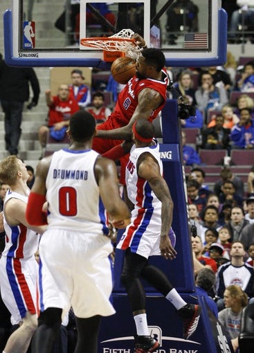 Jan 20, 2014; Auburn Hills, MI, USA; Los Angeles Clippers center DeAndre Jordan (6) makes a dunk against the Detroit Pistons during the third quarter at The Palace of Auburn Hills. Clippers beat the Pistons 112-103. Mandatory Credit: Raj Mehta-USA TODAY Sports
