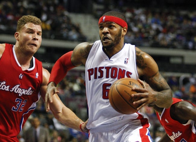 Jan 20, 2014; Auburn Hills, MI, USA; Detroit Pistons small forward Josh Smith (6) dribbles past Los Angeles Clippers power forward Blake Griffin (32) during the third quarter at The Palace of Auburn Hills. Clippers beat the Pistons 112-103. Mandatory Credit: Raj Mehta-USA TODAY Sports