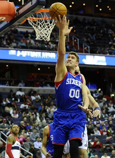 Jan 20, 2014; Washington, DC, USA; Philadelphia 76ers center Spencer Hawes (00) shoots against the Washington Wizards during the second half at Verizon Center. The Wizards defeated the 76ers 107 - 99. Mandatory Credit: Brad Mills-USA TODAY Sports