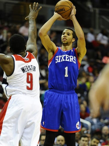 Jan 20, 2014; Washington, DC, USA; Philadelphia 76ers point guard Michael Carter-Williams (1) shoots over Washington Wizards small forward Martell Webster (9) during the second half at Verizon Center. The Wizards defeated the 76ers 107 - 99. Mandatory Credit: Brad Mills-USA TODAY Sports
