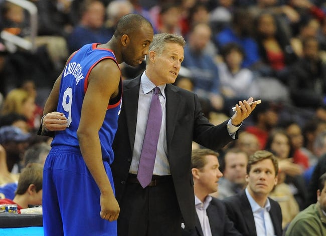 Jan 20, 2014; Washington, DC, USA; Philadelphia 76ers shooting guard James Anderson (9) talks with Philadelphia 76ers head coach Brett Brown against the Washington Wizards during the first half at Verizon Center. Mandatory Credit: Brad Mills-USA TODAY Sports