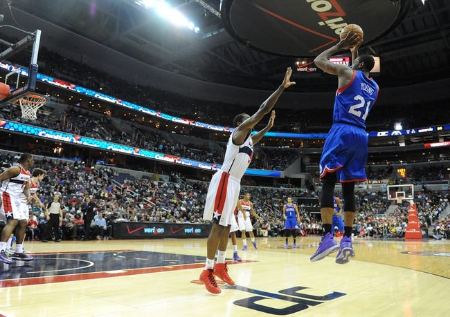 Jan 20, 2014; Washington, DC, USA; Philadelphia 76ers power forward Thaddeus Young (21) shoots over Washington Wizards small forward Martell Webster (9) during the second half at Verizon Center. The Wizards defeated the 76ers 107 - 99. Mandatory Credit: Brad Mills-USA TODAY Sports