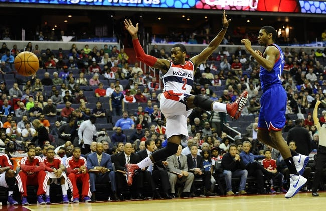 Jan 20, 2014; Washington, DC, USA; Washington Wizards point guard John Wall (2) is fouled by Philadelphia 76ers shooting guard Hollis Thompson (31) during the first half at Verizon Center. Mandatory Credit: Brad Mills-USA TODAY Sports
