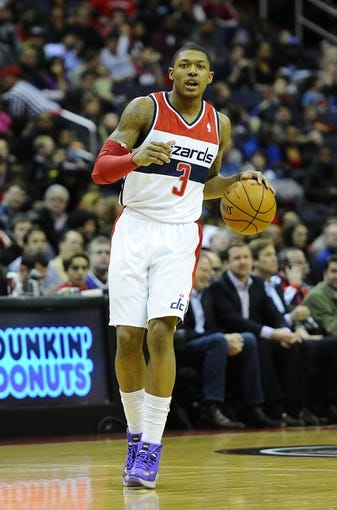 Jan 20, 2014; Washington, DC, USA; Washington Wizards shooting guard Bradley Beal (3) dribbles the ball against the Philadelphia 76ers during the first half at Verizon Center. Mandatory Credit: Brad Mills-USA TODAY Sports