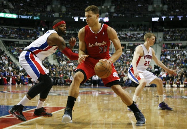 Jan 20, 2014; Auburn Hills, MI, USA; Los Angeles Clippers power forward Blake Griffin (32) gets defended by Detroit Pistons small forward Josh Smith (6) during the second quarter at The Palace of Auburn Hills. Mandatory Credit: Raj Mehta-USA TODAY Sports