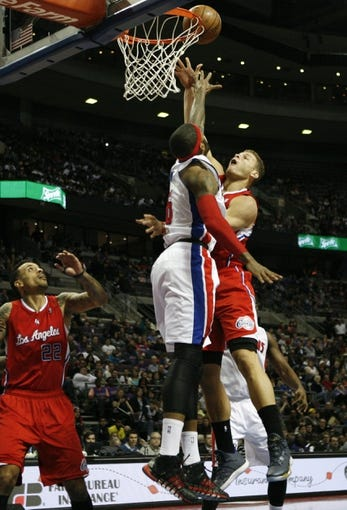 Jan 20, 2014; Auburn Hills, MI, USA; Los Angeles Clippers power forward Blake Griffin (32) takes a shot over Detroit Pistons small forward Josh Smith (6) during the second quarter at The Palace of Auburn Hills. Mandatory Credit: Raj Mehta-USA TODAY Sports