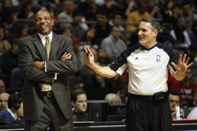 Jan 20, 2014; Auburn Hills, MI, USA; Los Angeles Clippers head coach Doc Rivers shares a laugh with a ref during the third quarter against the Detroit Pistons at The Palace of Auburn Hills. Clippers beat the Pistons 112-103. Mandatory Credit: Raj Mehta-USA TODAY Sports