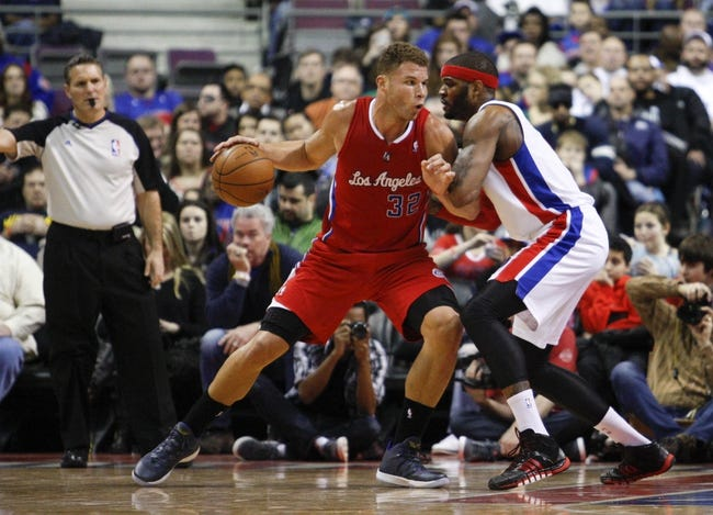 Jan 20, 2014; Auburn Hills, MI, USA; Los Angeles Clippers power forward Blake Griffin (32) gets defended by Detroit Pistons small forward Josh Smith (6) during the third quarter at The Palace of Auburn Hills. Clippers beat the Pistons 112-103. Mandatory Credit: Raj Mehta-USA TODAY Sports