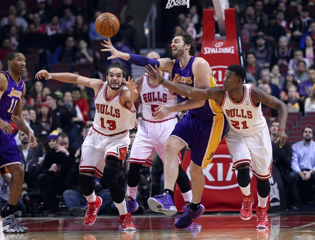 Jan 20, 2014; Chicago, IL, USA; Los Angeles Lakers center Pau Gasol (16) gets the ball knocked away by Chicago Bulls shooting guard Jimmy Butler (21) during the first half at United Center. Mandatory Credit: Mike DiNovo-USA TODeh ball knocked away AY Sports