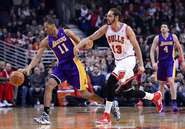 Jan 20, 2014; Chicago, IL, USA; Los Angeles Lakers small forward Wesley Johnson (11) dribbles the ball against Chicago Bulls center Joakim Noah (13) during the first half at United Center. Mandatory Credit: Mike DiNovo-USA TODAY Sports