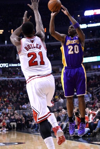 Jan 20, 2014; Chicago, IL, USA; Los Angeles Lakers shooting guard Jodie Meeks (20) shoots the ball against Chicago Bulls shooting guard Jimmy Butler (21) during the first half at United Center. Mandatory Credit: Mike DiNovo-USA TODAY Sports