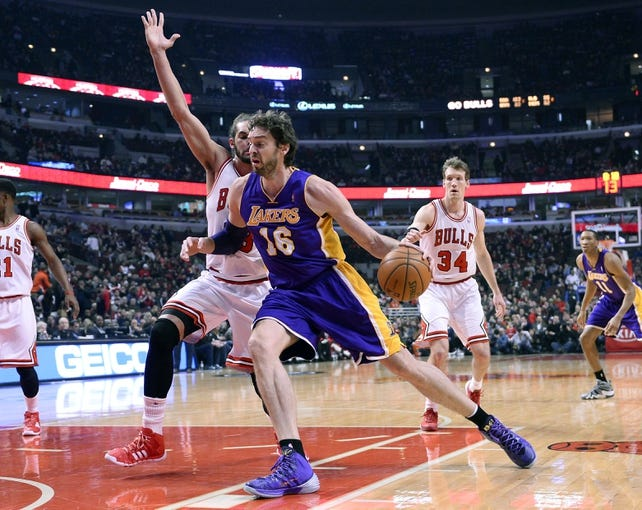 Jan 20, 2014; Chicago, IL, USA; Los Angeles Lakers center Pau Gasol (16) dribbles the ball against Chicago Bulls center Joakim Noah (13) during the first half at United Center. Mandatory Credit: Mike DiNovo-USA TODAY Sports