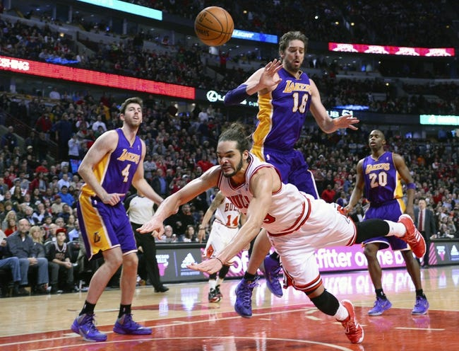 Jan 20, 2014; Chicago, IL, USA; Los Angeles Lakers center Pau Gasol (16) fouls Chicago Bulls center Joakim Noah (13) during the second half at United Center. The Bulls defeat the Lakers 102-100 in overtime. Mandatory Credit: Mike DiNovo-USA TODAY Sports