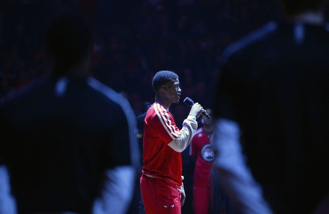 Jan 20, 2014; Chicago, IL, USA; Chicago Bulls shooting guard Jimmy Butler (21) speaks to the crowd in honor of Martin Luther King Jr. Day before the game against the Los Angeles Lakers at United Center. Mandatory Credit: Mike DiNovo-USA TODAY Sports