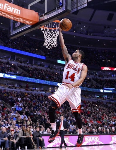 Jan 20, 2014; Chicago, IL, USA; Chicago Bulls point guard D.J. Augustin (14) shoots the ball against the Los Angeles Lakers during the second half at United Center. The Bulls defeat the Lakers 102-100 in overtime. Mandatory Credit: Mike DiNovo-USA TODAY Sports