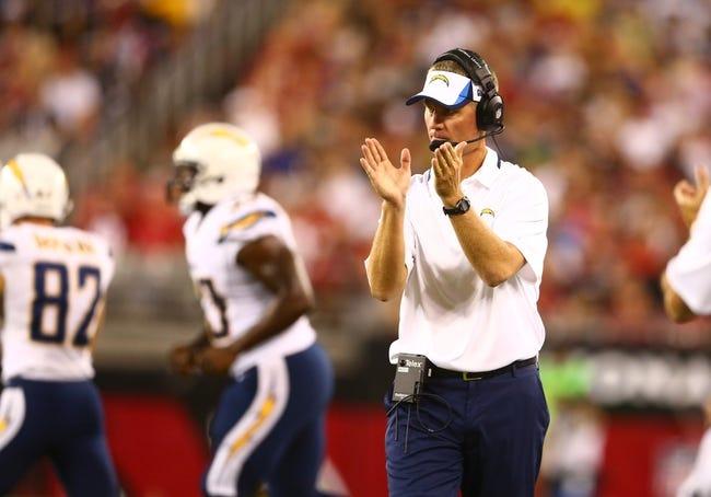 Aug. 24, 2013; Glendale, AZ, USA: San Diego Chargers head coach Mike McCoy against the Arizona Cardinals during a preseason game at University of Phoenix Stadium. Mandatory Credit: Mark J. Rebilas-USA TODAY Sports