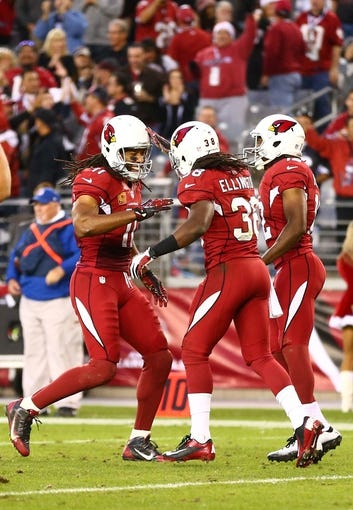 Dec 8, 2013; Phoenix, AZ, USA; Arizona Cardinals running back Andre Ellington (38) celebrates with Larry Fitzgerald (11) after scoring a touchdown in the fourth quarter against the St. Louis Rams at University of Phoenix Stadium. The Cardinals defeated the Rams 30-10. Mandatory Credit: Mark J. Rebilas-USA TODAY Sports