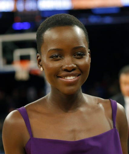 Jan 22, 2014; New York, NY, USA;  Entertainer and eactress Lupita Nyong'o from '12 Years A Slave' at Madison Square Garden. Philadelphia 76ers defeat the New York Knicks 110-105. Mandatory Credit: Jim O'Connor-USA TODAY Sports