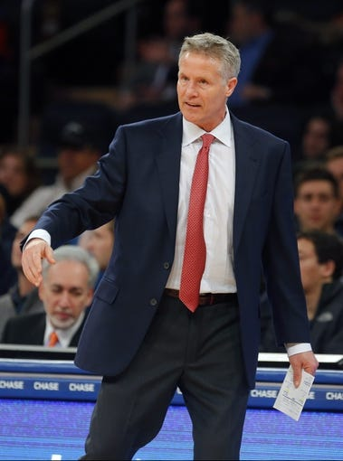 Jan 22, 2014; New York, NY, USA;  Philadelphia 76ers head coach Brett Brown during the second half against the New York Knicks at Madison Square Garden. Philadelphia 76ers defeat the New York Knicks 110-105. Mandatory Credit: Jim O'Connor-USA TODAY Sports