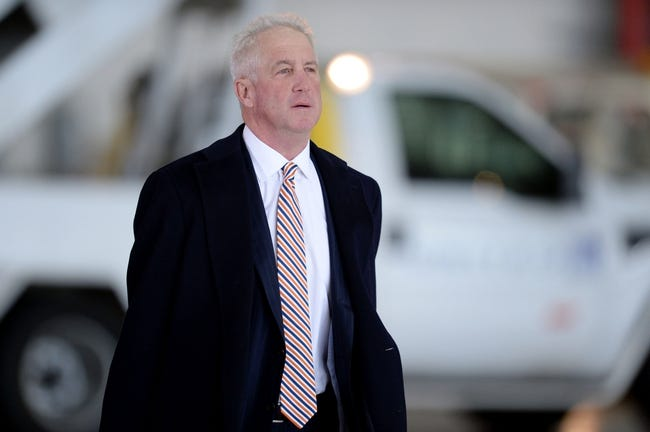 Jan 26, 2014; Newark, NJ, USA; Denver Broncos head coach John Fox arrives at Newark Liberty International Airport to face the Seattle Seahawks at Super Bowl XLVIII. Mandatory Credit: Joe Camporeale-USA TODAY Sports