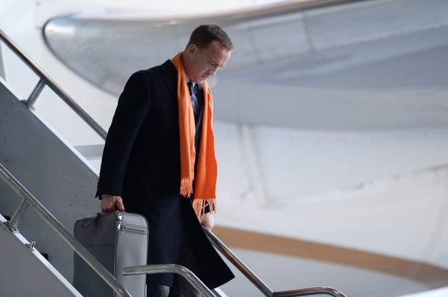 Jan 26, 2014; Newark, NJ, USA; Denver Broncos quarterback Peyton Manning arrives at Newark Liberty International Airport to face the Seattle Seahawks at Super Bowl XLVIII. Mandatory Credit: Joe Camporeale-USA TODAY Sports